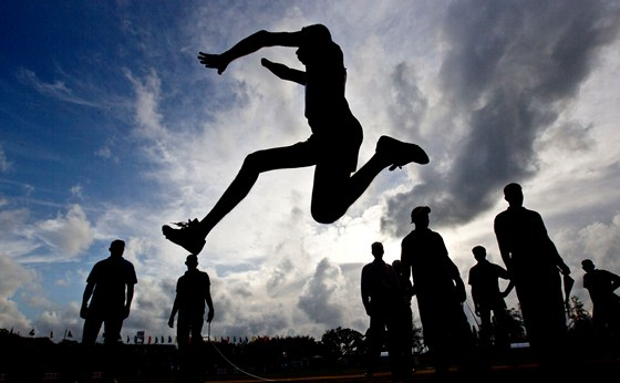 A disabled officer of Sri Lankan army participates in long-jump event during an athletic competition for disabled soldiers in Diyagama, suburbs of Colombo, Sri Lanka, Tuesday, Aug 14, 2012. Tens of thousands of soldiers were wounded in a quarter-century civil war between government troops and separatist Tamil Tiger rebels which ended in 2009 after Sri Lankan soldiers crushed the rebels. (AP Photo/Gemunu Amarasinghe)
